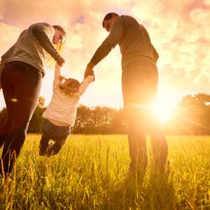 sun setting with mom, dad, and child